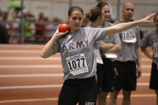 A cadet prepares to hurl a shot in the shot-put event at Indiana  University.  The shot-put is one of many events that were held at Indiana University and Camp Atterbury to earn the German Proficiency Badge.