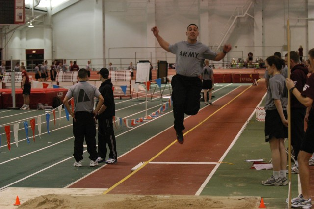 A cadet jumps as far as he can in the long-jump event at Indiana  University.  The long jump is one of the many events that were held at Indiana  University and Camp Atterbury to earn the German Proficiency Badge.