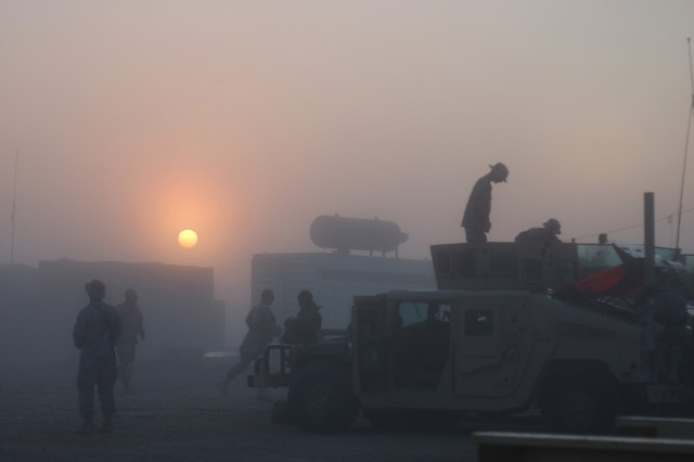 Soldiers from 2nd Platoon, Battery A, 1st Battalion, 319th Airborne Field Artillery Regiment prepare for a early morning mission Feb. 17, out of Contingency Operating Base Speicher in Tikrit, Iraq.