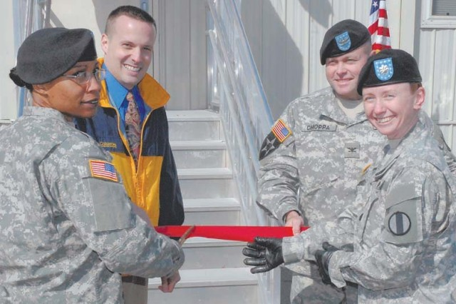 The English as a Second Language program was welcomed to Fort Jackson during a ribbon cutting ceremony at the Arabic Interpreter/Translator School on Thursday. From left, Capt. Shareefah McCoy, commander, Company E, 187th Ordnance Battalion; Clayton Leishman, ESL program manager; Col. Robert Choppa, commander, Victory Brigade; and Lt. Col. Kerry MacIntyre, commander, 187th Ord. Bn.""
