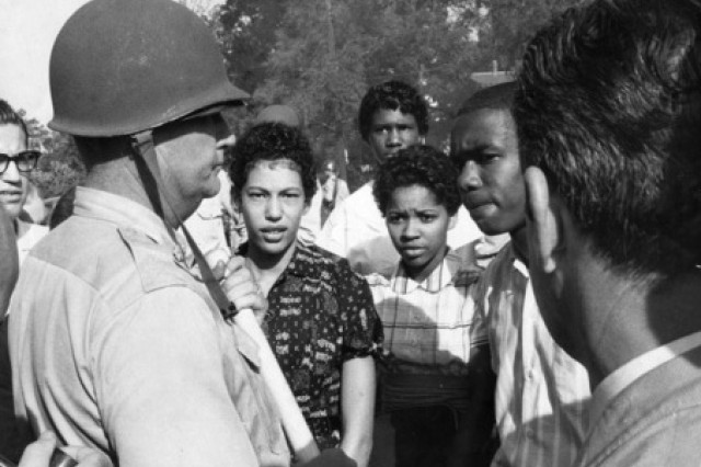 Sept. 4, 1957 - Lt. Col. Marion Johnson, commander of National Guard troops, turns back a group of African Americans seeking to enter Central High School today. He said he was acting on orders of Governor Faubus not to admit them.