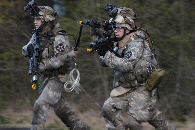 Soldiers from the 4th Brigade, 2nd Infantry Division, conduct a raid on Leschi Town during recent pre-deployment training at Fort Lewis, Wash.
