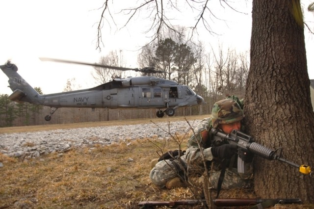 A Soldier pulls security during a medical evacuation exercise.