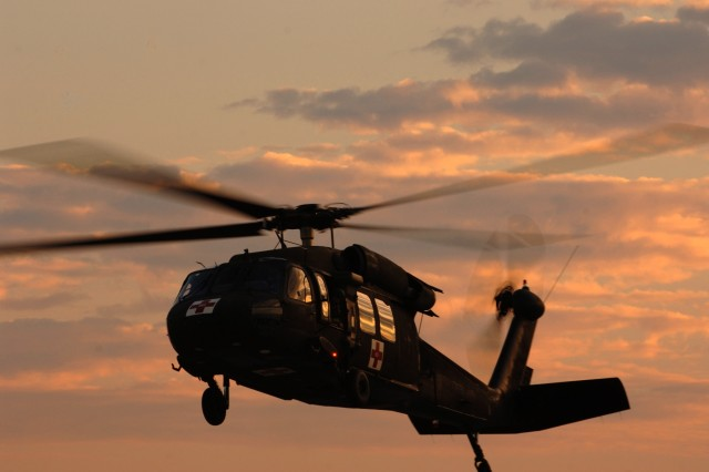 A UH-60 Black Hawk air ambulance helicopter prepares to land for refueling.