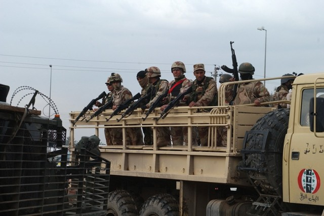 More Iraqi Soldiers arrive in the neighborhood for the foot patrol.