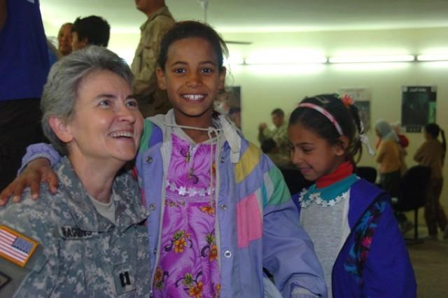 A Soldier visits Iraqi children.