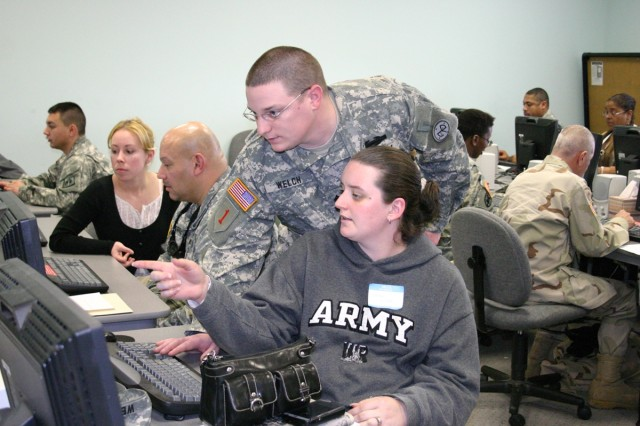 Cpl. Matther Welch and his wife, Diana, work during the resume writing workshop at the Hiring Heroes Job Fair for wounded and injured Soldiers held at Fort Dix, N.J. Feb. 27 and 28. More than 300 Soldiers attended the event.