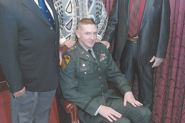 Maj. Charles McPhail upholds a long tradition of military service in his family. His father and grandfathers reunited to pin his oakleaves at a promotion ceremony.