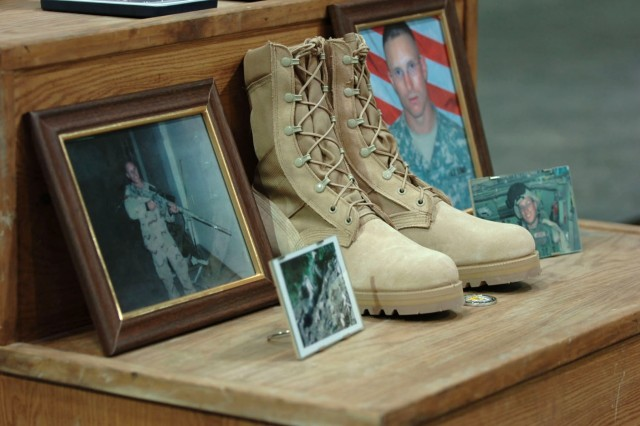 These boots and pictures of Staff Sgt. Daniel Morris serve as a reminder of his dedication to duty and sacrifice while doing what he believed in.