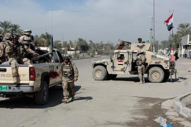 Iraqi Soldiers begin their patrol of Sadr City.