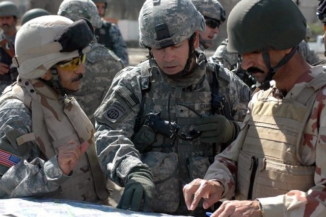 Brig. Gen. John F. Campbell, deputy commander for maneuver, Multi-National Division  Baghdad, discusses Sadr City plans with Brig. Gen. Ali, commander, 8th Brigade, 2nd Iraqi National Police Division.