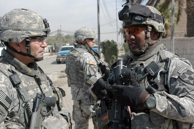 Brig. Gen. John F. Campbell (left) discusses the operation with Lt. Col. Smiley, commander, 1st Battalion, 23rd Infantry (Stryker).