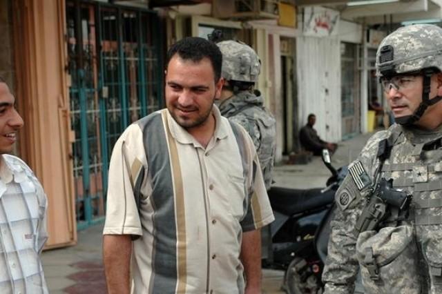 Brig. Gen. John F. Campbell speaks with Sadr City residents.