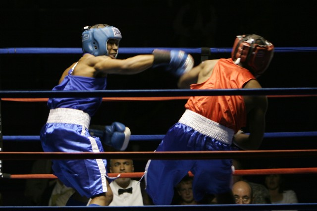 Quadi Hudgins, in blue, from Fort Campbell, Ky., knocks down Travis Benford from Fort Stewart, Ga., during the All Army Boxing Championships at Fort Huachuca, Ariz., March 1-2.