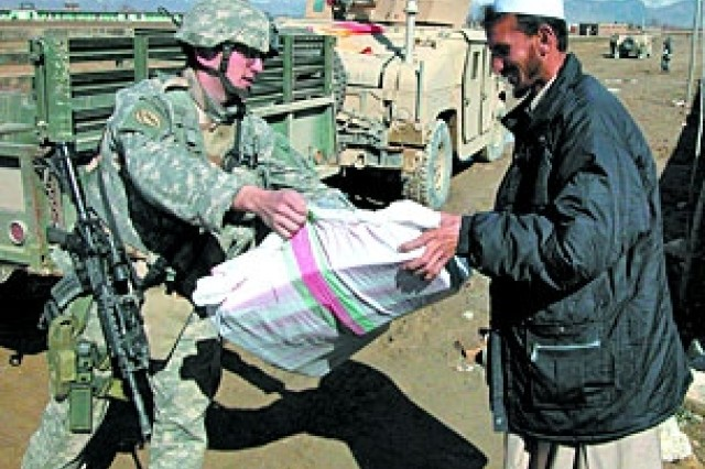 Soldiers Provide Supplies for Women's Day