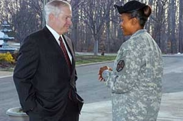 Defense Secretary Robert Gates talks with Fort Belvoir Command Sgt. Maj. Tracey Anbiya before addressing enlisted service members at the Community Club on March 1
