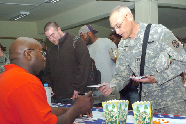 Sgt. 1st Class James Deal, 3rd Infantry Division (The Old Guard) chats with Kansas City Chiefs' guard Will Shields. Shields joined Alge Crumpler, Shelton Quarles and Ben Watson on a 12-day trek through the Middle East, made possible by USO.