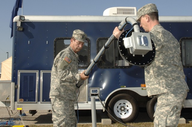 Master Sgt. Michael Winkler, left, and Chief Warrant Officer Ken Drennon of the South Carolina Army National Guard set up a Web Cam as part of Defense Interoperability Communication Exercise 2007 at Fort Monroe, Va., Feb. 28, 2007.