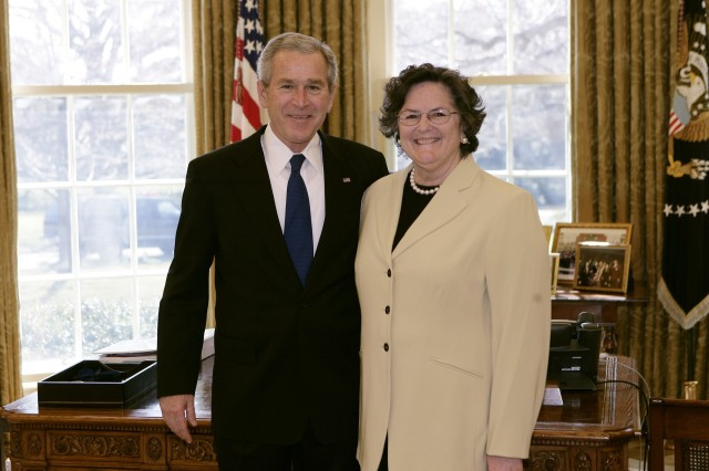 President George W. Bush meets with Ellen Minette, the 2007 National Middle Level Principal of the Year, in the Oval Office Tuesday, March 6, 2007. Minette is principal of the Department of Defense Education Activity's Heidelberg Middle School in Heidelberg, Germany.