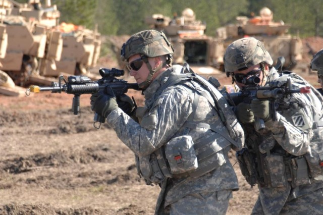 Soldiers rehearse tactics.