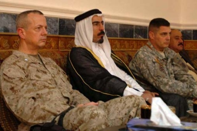 U.S. Marine Brig. Gen. John Allen, deputy commander for Multinational Force-West, and Col. John Charlton, 1st Brigade, Combat Team, 3rd Infantry Division commander, sit with Sheik Abdul Sattar and Ramadi Mayor Latif Iyada during the Ramadi Reconstruction Conference, March 7, 2007.