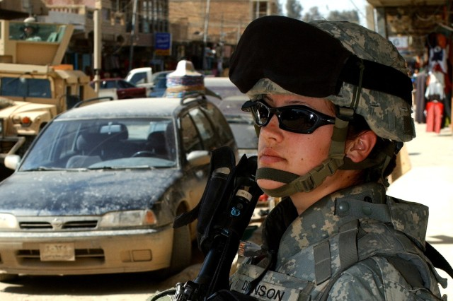 Pfc. Ashley Denson, a medic from the 82nd Brigade Support Battalion, provides convoy security in Samarra, Iraq, Feb. 28.