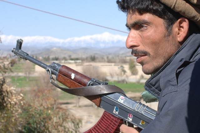 An Afghan National Policeman provides security for the district center in Sabari, March 6, while U.S. Soldiers are meeting with the local sub-governers to determine the progress in the region.