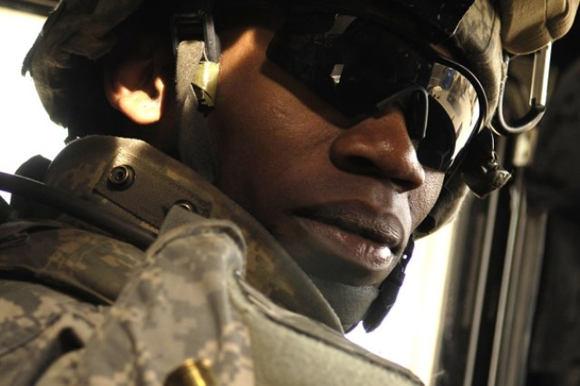 Pfc. Brandon Stanfield awaits orders for his convoy to move out for a patrol of Riyahd village in Iraq March 8. Stanfield is with the 3rd Brigade Combat Team, 25th Infantry Division.