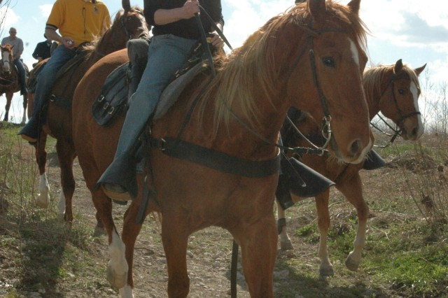 """Martha Raddatz, the senior White house correspondent for ABC News, goes for a trail ride March 10, with the 1st Cavalry Division Horse Cavalry Detachment while at Fort Hood for the signing of her new book """"The Long Road Home."""" The book documents the First Team's April 2004 battle in Sadr City that killed eight troopers and wounded more than 60 others."""