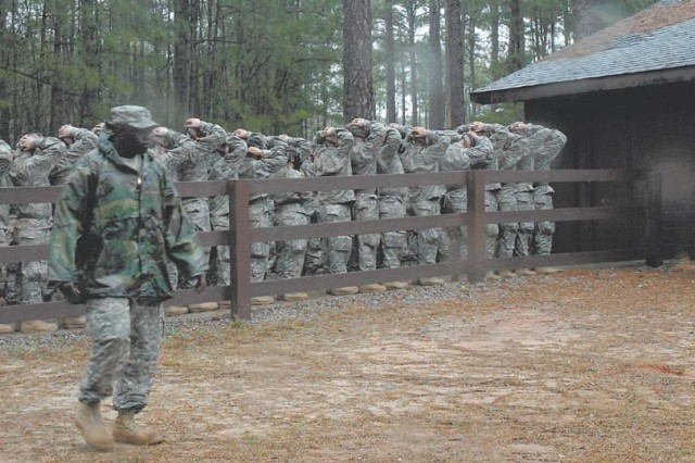 Soldiers from Company A, 2nd Battalion, 60th Infantry Regiment line up to enter the NBC chamber, while a range cadre ensures everything runs smoothly.