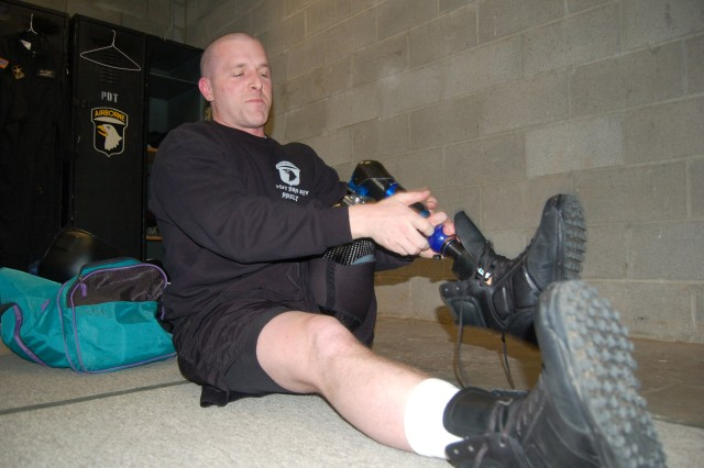 Spc. Max Ramsey, who lost his left leg in Iraq in March 2006, puts on his jump boots in preparation for his first jump as a member of the Screaming Eagles Parachute Demonstration Team at Fort Campbell, Ky., March 13.