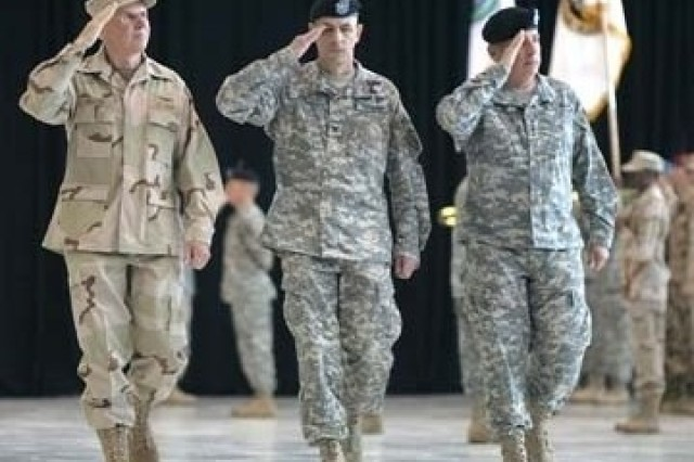 Gen. John P. Abizaid (right) inspects the troops for a final time during the Change of Command ceremony at MacDill Air Force Base, Tampa, Fla., as Col. Shawn Mateer, ceremony commander of troops, and incoming commander Adm. William J. Fallon (left) render salutes.
