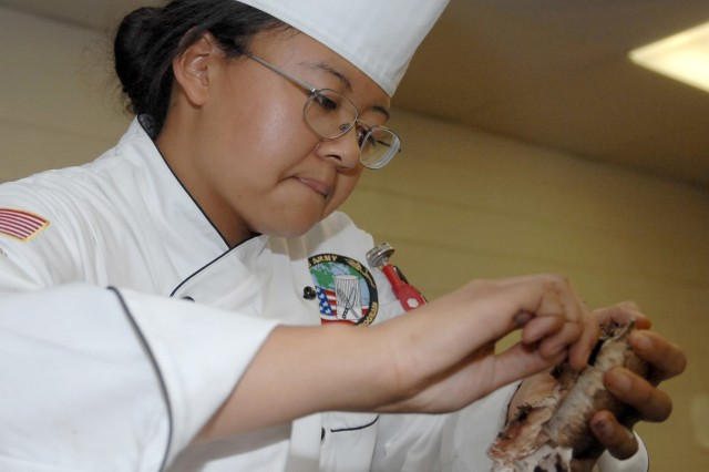Team Hawaii's Pfc. Donna Major prepares mushrooms for cooking.