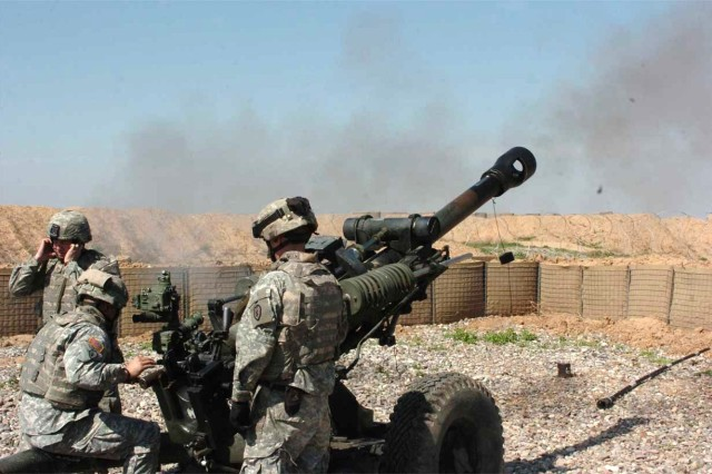 The Soldiers fire their howitzer.