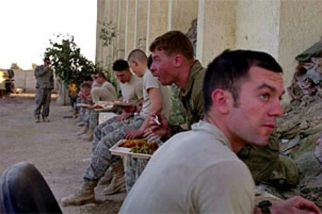 The Company B, 1st Battalion, 8th Cavalry Regiment soldiers enjoy a hot meal before going out on a mission at Forward Operating Base Hope in Baghdad, Iraq, March. 14.