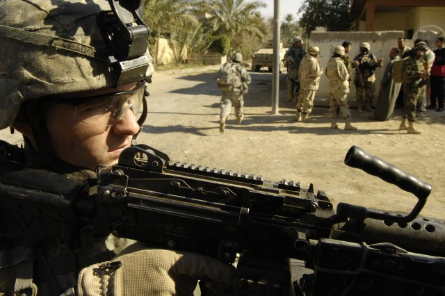 Spc. Justin Meadow provides security for Iraqi Soldiers.