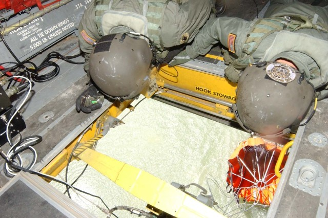Staff Sgt. Michael Wagner (left) and Sgt. Chris Salmond check the position of their 2,000 gallon bucket.