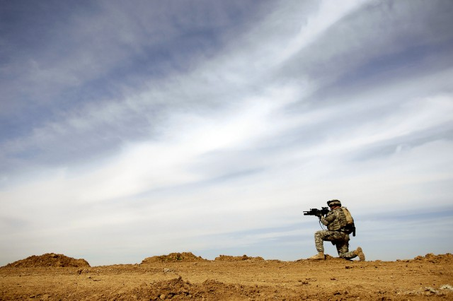 Sgt. Justin Walker provides security during a patrol of the Riyadh village in Iraq, March 8. Walker is from Company D, 2nd Battalion, 27th Infantry Regiment, 3rd Brigade Combat Team, 25th Infantry Division.