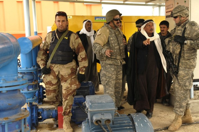 Soldiers and residents tour the new water treatment plant.