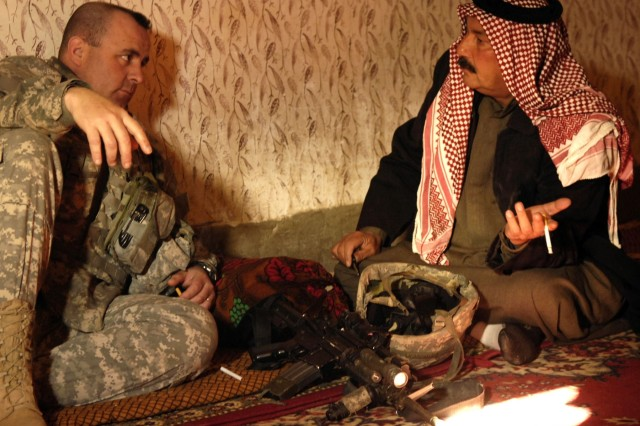 Lt. Col. Drew Meyerowich speaks to Sheik Ibrahim, the Muqtar of Mahuz, about ways to use government channels to solve other infrastructure problems.