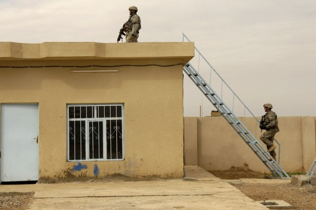 Soldiers provide security during the opening of the water treatment plant.