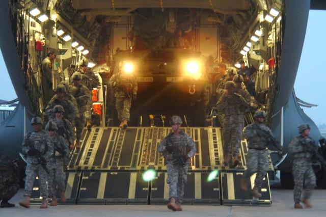 Soldiers from 1st Battalion, 27th Infantry Division and their M1126 Stryker Infantry Carrier Vehicle exit a C-17 Globemaster aircraft March 18, at Daegu Air Base, South Korea, during the start of Exercise Foal Eagle 2007.