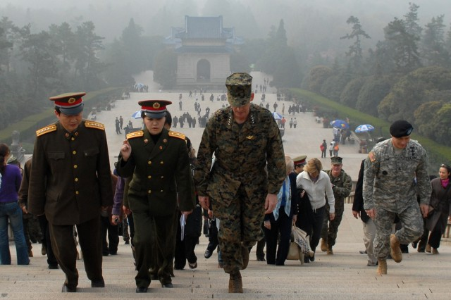 """Gen. Pace, Sgt. Maj. Gainey and other Soldiers are given a tour of the Dr. Sun Yat-Sen Mausoleum in Nanjing. A Chinese reporter asked Pace if he considered China a threat to the United States. """"I believe a threat has two parts to it: One part is capability and the other part is intent,"""" Pace said. """"Both the armed forces of the United States and China have great capabilities or capacities. But neither country has the intent to attack the other country. Because of that we are not a threat to each other."""""""