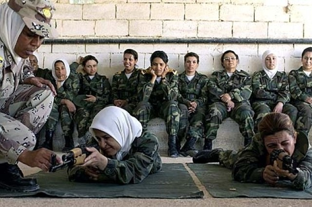 Jordanian Warrant Officer Emad instructs trainees from the second class of female Iraqi Army soldiers on proper breathing techniques while firing an AK-47, part of their basic training at the Jordanian Royal Military College in Jordan.