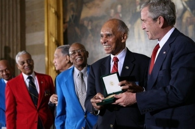 President George W. Bush presents the Congressional Gold Medal to Dr. Roscoe Brown Jr., during ceremonies honoring the Tuskegee Airmen Thursday, March 29, at the U.S. Capitol. Brown, Director of the Center for Urban Education Policy and University Professor at the Graduate School and University Center of the City University of New York, commanded the 100th Fighter Squadron of the 332 Fighter Group during World War II.