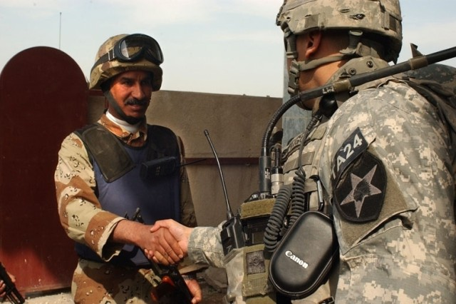 Staff Sgt. Manuel Sahagun greets an Iraqi Soldier before the operation.