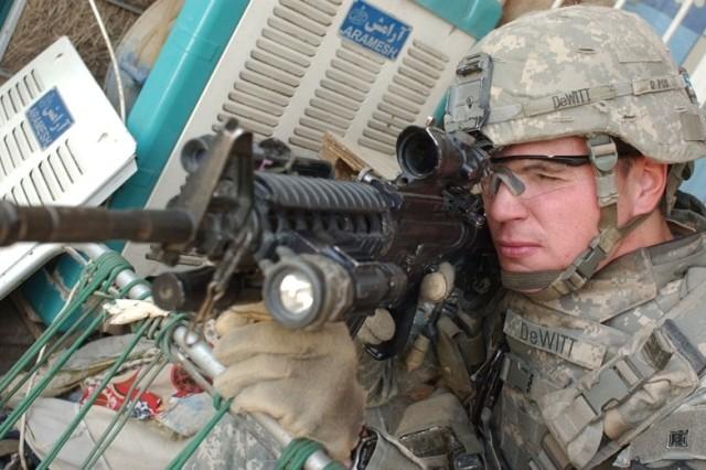 1st Lt. Matthew DeWitt scans rooftops for snipers.