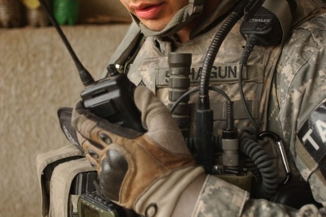 Staff Sgt. Manuel Sahagun maintains radio contact with his unit.