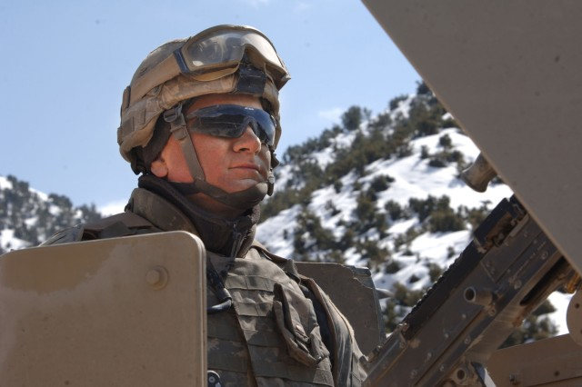 Spc. Victor Piacente, from the Connecticut National Guard, scans his sector while his convoy stops for a break during an extended patrol in Gardez Province.