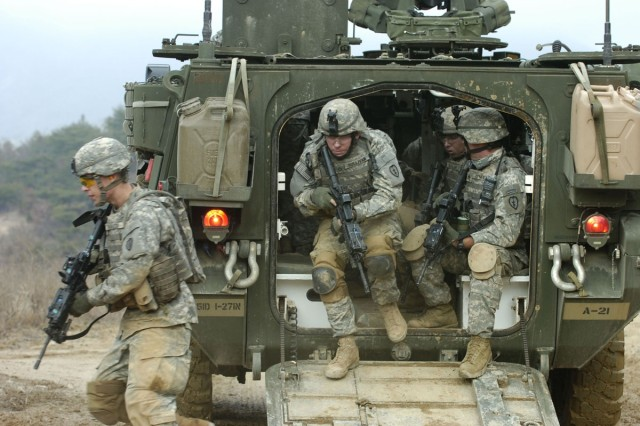 Soldiers exit their M1126 Stryker Infantry Carrier Vehicle during dismounted maneuvers at Warrior Valley on Rodriguez Range Complex.